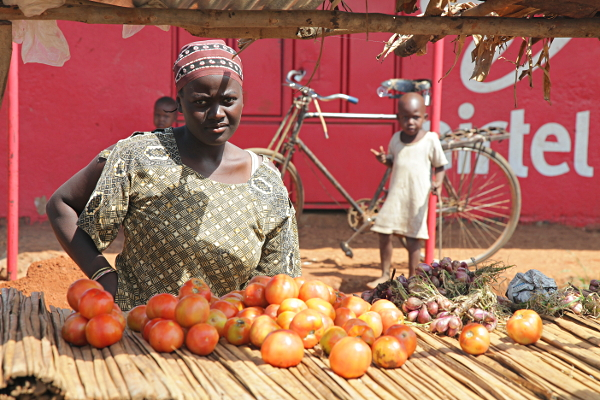 Tomato and Garlic Seller on the road to Mbale, Uganda