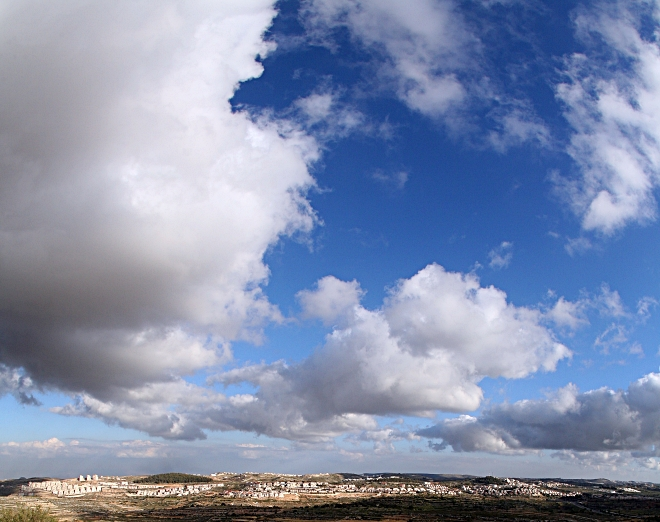 Panoramic View of Efrat Under Clouds